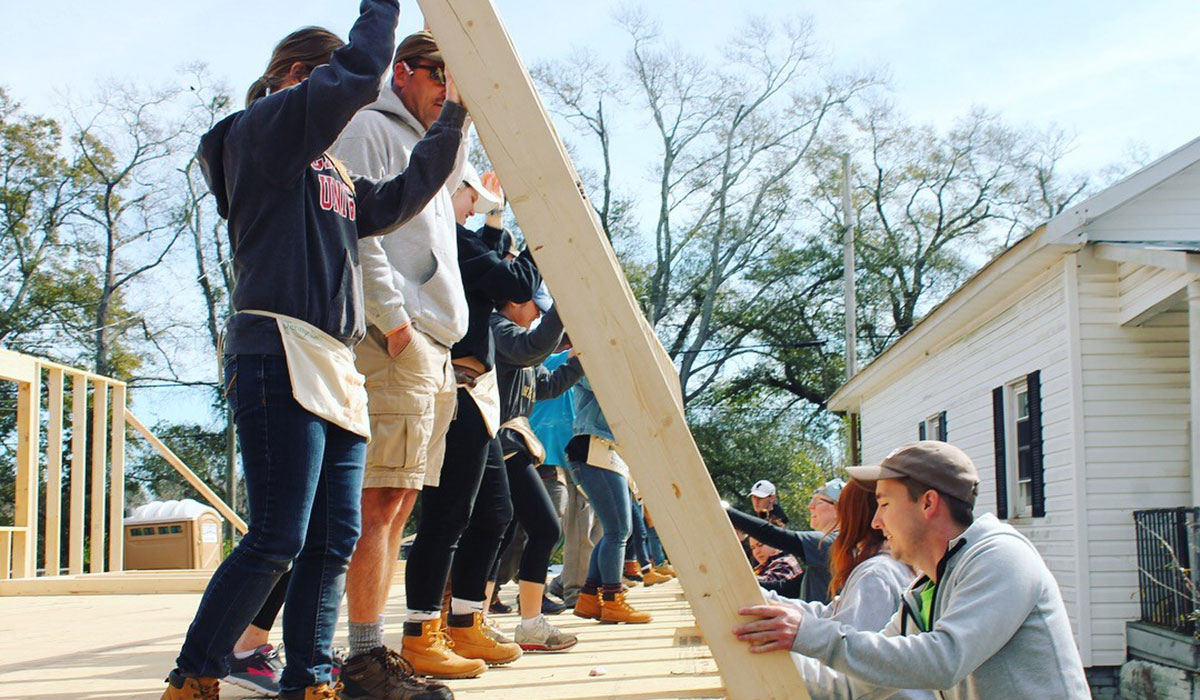 Habitat for Humanity students building house